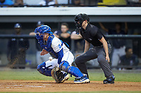 Burlington Royals catcher William Hancock (7) blocks a pitch in the dirt as home plate umpire Lane Culipher looks on during the game against the Pulaski Yankees at Burlington Athletic Stadium on August 25, 2019 in Burlington, North Carolina. The Yankees defeated the Royals 3-0. (Brian Westerholt/Four Seam Images)