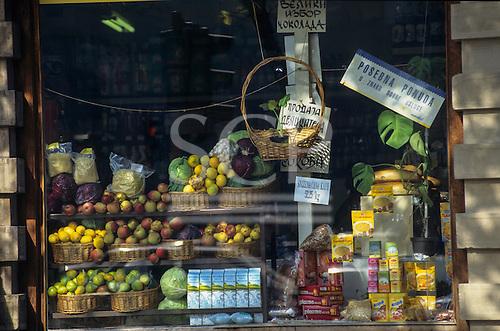 Belgrade, Serbia. Open grocery store market stall with baskets of fruit - apples lemons, juice, Lipton tea, Nesquik local prices.