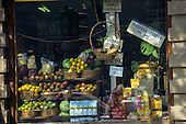 Belgrade, Serbia. Open grocery store market stall with baskets of fruit - apples lemons, juice, Lipton tea, Nesquik local prices.