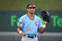 Center fielder Bubba Thompson (25) of the Hickory Crawdads warms up before a game against the Greenville Drive on Monday, August 20, 2018, at Fluor Field at the West End in Greenville, South Carolina. Hickory won, 11-2. (Tom Priddy/Four Seam Images)