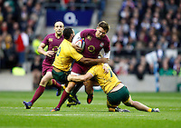 Photo: Richard Lane/Richard Lane Photography. England v Australia. QBE Autumn Internationals. 17/11/2012. England's Toby Flood is tackled by Australia's Kurtley Beale and Michael Hooper.