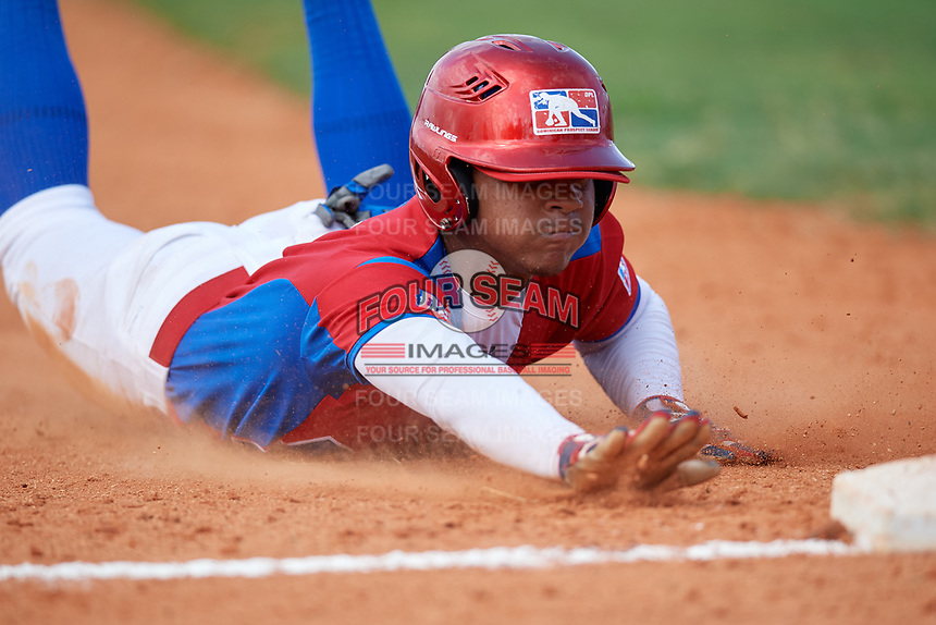 Enmanuel Bonilla (6) slides into third base during the Dominican Prospect League Elite Florida Event at Pompano Beach Baseball Park on October 14, 2019 in Pompano beach, Florida.  (Mike Janes/Four Seam Images)