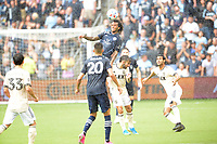KANSAS CITY, KS - JUNE 26: Gianluca Busio #10 Sporting KC wins the header during a game between Los Angeles FC and Sporting Kansas City at Children's Mercy Park on June 26, 2021 in Kansas City, Kansas.