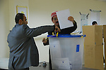 DUHOK, IRAQ:  A convict casts his ballot in the Duhok Prison...Three days before the polls open, military and convicts vote in the Iraqi Parliamentary Elections...Photo byAri Jalal/Metrography