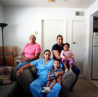 USA. Houston. 12 November 2007..Jovelle Joubert, Linda Carty's daughter with her son Jhori (middle), photographed with Linda's mother Enid Carty (left), and Linda's sister Isalyn with her granddaughter Jada(right). Photographed in Enid Carty's  apartment in Houston..©Andrew Testa