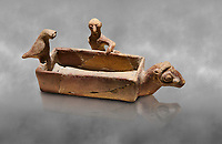 Assyrian Trader Colony Bronze Age terracotta sandal shaped ritual vessed. This cult pot is boat shaped with an animal head at the front. Inside the vessel is god. The deities associated with the ritual vessel were associated with trade and transportation in Ancient Mesopotamia and Summerian literature. The vessel signifies a religious river trip.  - 19th  century BC - Kültepe Kanesh - Museum of Anatolian Civilisations, Ankara, Turkey.