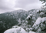 Looking across King Ravine at Mount Madison from Crag Camp in the Northern Presidential Range in the White Mountains, New Hampshire on a typical cloudy winter day above treeline. Built in 1909, Crag Camp was the private camp of Nelson H. Smith. A new camp was built in 1993.