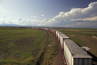 AJ3617, train, railroad, A freight train stretches for miles along the tracks on the flat prairie near Blowning in the state of Montana.