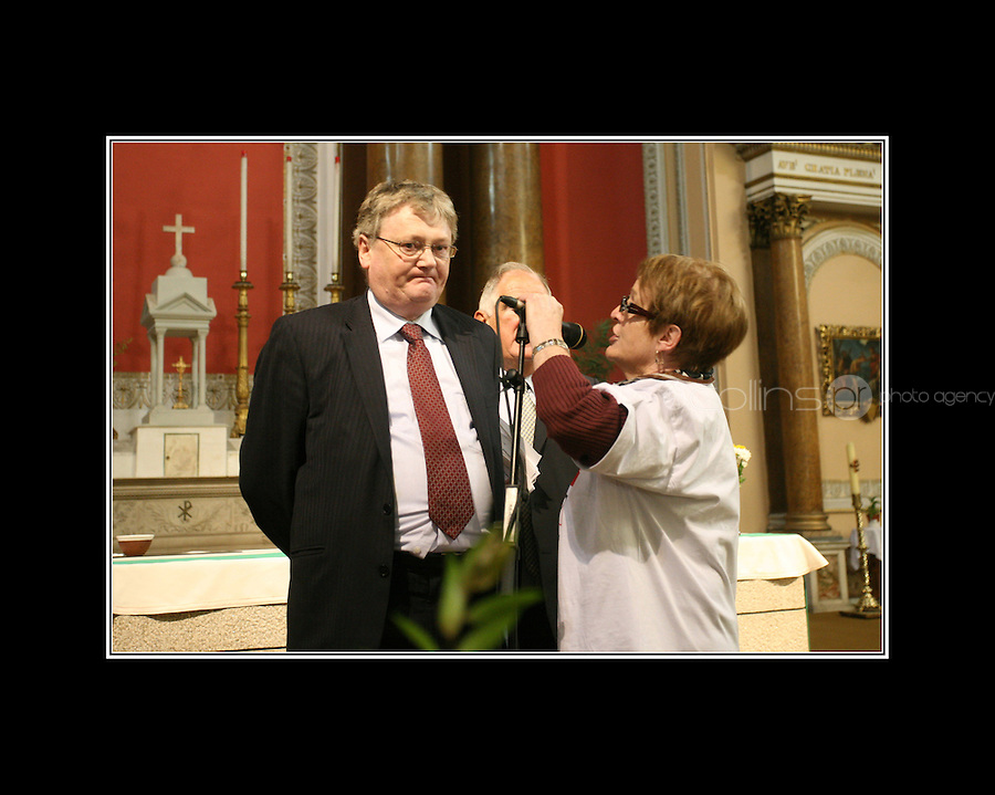 Minister of state at the Department of Health John Moloney TD gets heckeld by pensioner Margaret Gaynor from Dalkey during an Age Action briefing over the medical-cards controversy at Westland Row Church, Dubin..
