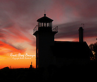 A winter sunset silhouettes the Bristol Ferry Lighthouse