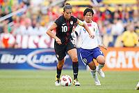 14 MAY 2011: USA Women's National Team midfielder Carli Lloyd (10) dribbles the ball past Japan National team Shinobu Ohno during the International Friendly soccer match between Japan WNT vs USA WNT at Crew Stadium in Columbus, Ohio.