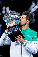 21st February 2021, Melbourne, Victoria, Australia; Novak Djokovic of Serbia kisses his trophy after winning the Men's Singles Final of the 2021 Australian Open on February 21 2021, at Melbourne Park in Melbourne, Australia.