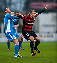 Ayr Utd's Player / Manager Mark Roberts claims for a foul after being barged by Queen of the South's Mark Durnan.