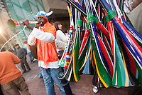 A vendor blows a vuvuzuela from his stand along the Cape Town fan walk before the 2010 FIFA World Cup semi-final between the Netherlands and Uruguay at Greenpoint Stadium in Cape Town, South Africa on Tuesday, July 6, 2010.  Netherlands defeated Uruguay 3-2.