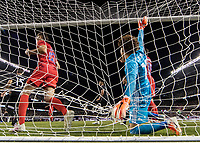CHICAGO, IL - JULY 7: Mexico goalkeeper Guillermo Ochoa #13 ends up in the net after being pushed by Aaron Long #23 during a game between Mexico and USMNT at Soldiers Field on July 7, 2019 in Chicago, Illinois.