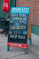 A sign at Fenway Park's Bleacher Bar indicates a 15% discount when ordering online using the code COVIDSTINX2020, a reference to the ongoing Coronavirus (COVID-19) global pandemic, in Boston, Massachusetts, on Wed., Jan. 6, 2021.