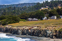 Coastal homes  around the Sea Ranch Meadow, coastal bluff above Pebble Beach, protected by hedgerows for privacy and wind protection
