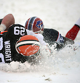 December 16th, 2007:  Buffalo Bills safety Jim Leonhard (43) tackles Cleveland Browns running back Jason Wright (29) in the snow at Cleveland Browns Stadium in Cleveland, Ohio.  The Browns shutout the Bills 8-0 to inch closer to clinching a playoff spot.  Photo Copyright Mike Janes Photography.