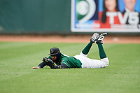 Great Lakes Loons right fielder Carlos Rincon (40) makes a diving catch in the outfield during a game against the Burlington Bees on May 4, 2017 at Dow Diamond in Midland, Michigan.  Great Lakes defeated Burlington 2-1.  (Mike Janes/Four Seam Images)