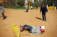 A tourist falls off of her sand-slide in the Shapotou Tengger desert resort near the city of Zhongwei, in Ningxia Province. The park was established next to a Chinese Academy of Sciences research station, involved in studies investigating desertification control measures. The Shapotou park draws thousands of visitors who ride camels, do sand sliding and take boat rides on the nearby Yellow River.