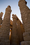 Luxor, Egypt -- The great hypostyle hall in Karnak Temple.  At the back of the hall, the tourist may find unfinished columns, in the process of renovation or perhaps reflecting work that was never completed by the original builders.  Karnak was built, rebuilt, and expanded upon over many generations of Egyptian pharaoh, as each successive king added pieces to this temple honoring the most significant god of the ancient Egyptian pantheon, the god Amun (later, Amon-Ra), the sun god. © Rick Collier / RickCollier.com