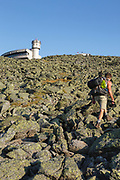 Appalachian Trail - A hiker approaches the summit of Mount Washington in the White Mountains, New Hampshire USA.