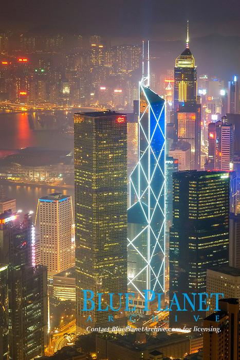 Hong Kong's modern skyline overlooking Victoria harbour and Kowloon peninsula at night, Hong Kong, China