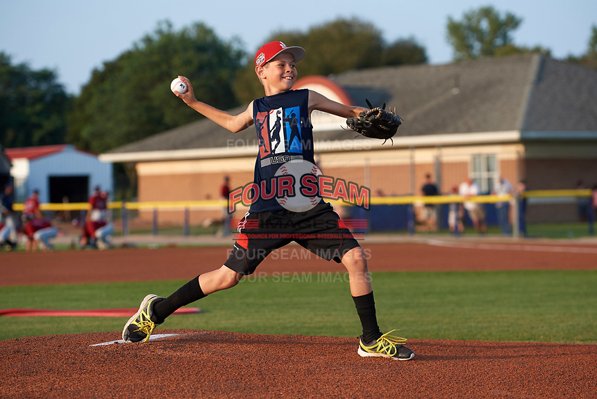 Batavia Muckdogs youth baseball clinic participant throws out the ceremonial first pitch before a game against the Mahoning Valley Scrappers on August 30, 2017 at Dwyer Stadium in Batavia, New York.  Batavia defeated Mahoning Valley 5-1.  (Mike Janes/Four Seam Images)