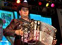 """voz-FoodCityFiestas0919 091407 A member from the group """"Los Originales Cadetes de Linares"""" (cq) performed at the Food City Fiestas Patrias in Phoenix, on Friday, Sept. 14, 2007.  Photo by AJ Alexander/La Voz"""