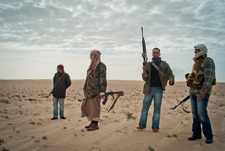Rebel fighters group in the desert outside of Ajdabiya, Libya.