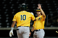 AZL Athletics Gold Santis Sanchez (10) is congratulated by Shane Selman (13) after hitting a home run during an Arizona League game against the AZL Cubs 1 at Sloan Park on June 20, 2019 in Mesa, Arizona. AZL Athletics Gold defeated AZL Cubs 1 21-3. (Zachary Lucy/Four Seam Images)
