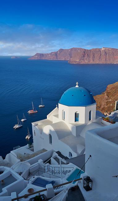 Traditional blue domed Greek Orthodox church of Oia, Island of Thira, Santorini, Greece.