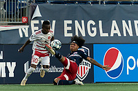 FOXBOROUGH, MA - AUGUST 21: Mutaya Mwape #10 of Richmond Kickers and Isaac Angking #5 of New England Revolution II battle for the ball during a game between Richmond Kickers and New England Revolution II at Gillette Stadium on August 21, 2020 in Foxborough, Massachusetts.