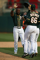 OAKLAND, CA - SEPTEMBER 25:  Starling Marte #2 of the Oakland Athletics celebrates after hitting an RBI double to drive in teammate Elvis Andrus #17 from first base in bottom of the 9th inning to beat the Houston Astros 2-1 during the game at the Oakland Coliseum on Saturday, September 25, 2021 in Oakland, California. (Photo by Brad Mangin)