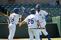 South Bend Cubs Eloy Jimenez (27) high fives Eddy Martinez (15) after hitting a home run during the second game of a doubleheader against the Peoria Chiefs on July 25, 2016 at Four Winds Field in South Bend, Indiana.  South Bend defeated Peoria 9-2.  Wearing 25 is the batboy.  (Mike Janes/Four Seam Images)