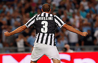 Calcio, Supercoppa di Lega: Juventus vs Lazio. Roma, stadio Olimpico, 18 agosto 2013<br /> Juventus defender Giorgio Chiellini celebrates after scoring during the Italian League Supercup football final match between Juventus and Lazio, at Rome's Olympic stadium,  18 August 2013.<br /> UPDATE IMAGES PRESS/Riccardo De Luca