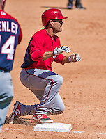 14 March 2014: Washington Nationals infielder Jamey Carroll slides safely into third with a triple during a Spring Training game against the Detroit Tigers at Joker Marchant Stadium in Lakeland, Florida. The Tigers defeated the Nationals 12-6 in Grapefruit League play. Mandatory Credit: Ed Wolfstein Photo *** RAW (NEF) Image File Available ***