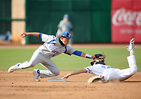 Rogers High School shortstop Noah Goodshield makes the tag on Harb-Ber High School's Clark Jenkins during play Monday, April 26, 2021, at Arvest Ballpark in Springdale. Check out nwaonline.com/210427Daily/ and nwadg.com/photos for a photo gallery.<br /> (NWA Democrat-Gazette/David Gottschalk)