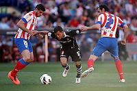 Atletico's Insua, Godin (r) and Granada's Buonanotte during La Liga BBVA match. April 14, 2013.(ALTERPHOTOS/Alconada)