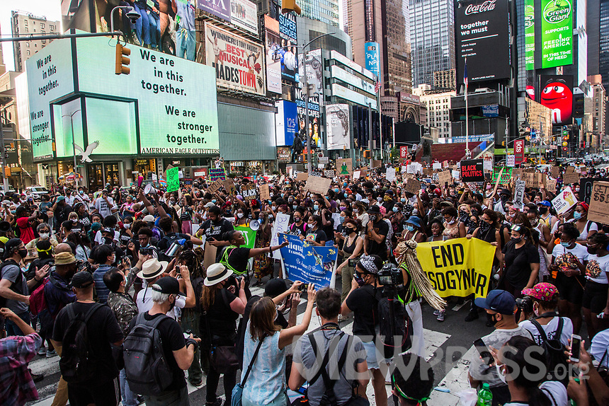 """NEW YORK, NY - JULY 26: A large crowd of protesters gather in Times Square in New York, NY on July 26, 2020. Hundreds of New York activists participated in a march to condemn what they see as excessive focus. from federal authorities in Portland, Oregon and continue to support the different movements of """"Black Lives Matter"""" (Photo by Pablo Monsalve / VIEWpress via Getty Images)"""