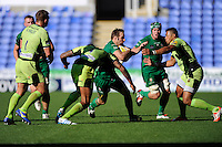 Tomas O'Leary of London Irish is tackled by Luther Burrell (right) and Courtney Lawes of Northampton Saints during the Premiership Rugby match between London Irish and Northampton Saints at the Madejski Stadium on Saturday 4th October 2014 (Photo by Rob Munro)