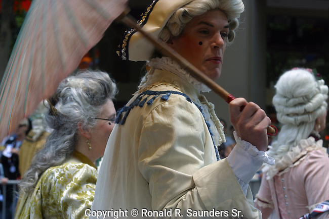Gay Pride Parade participant dressed in 18th century English garb costume<br />