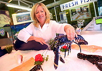 COPY BY TOM BEDFORD<br /> Annabble Denty of Coakley-Greene Fishmongers holding the rare blue lobster called Chelsea, believed to be one in 2,000,000 that was caught off the coast of Scotland, at Coakley Greene fishmongers in the indoor market, Swansea, Wales, UK.