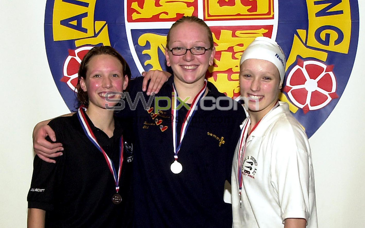 Pix: Matthew Lewis/SWpix.com. National Age Group Championships, Ponds Forge International Sports Centre, Sheffield. 1/08/2001..COPYWRIGHT PICTURE>>SIMON WILKINSON>>01943 436649>>..Girls 15 years 100m Backstroke Final medal Presentation. (From L to R). Julia Beckett, Winchester (Bronze), Kerrie Wassell, Co Birmingham (Gold), Rebecca Price, Cheadle (Silver).