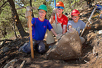 Photo story of Philmont Scout Ranch in Cimarron, New Mexico, taken during a Boy Scout Troop backpack trip in the summer of 2013. Photo is part of a comprehensive picture package which shows in-depth photography of a BSA Ventures crew on a trek.  In this photo a BSA Venture Crew proudly display a large boulder that the dug up while working to cut a new trail, during the Venture Crews conservation project in the backcountry at Philmont Scout Ranch.   <br /> <br /> The  Photo by travel photograph: PatrickschneiderPhoto.com