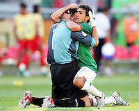 Mexico goalkeeper Oswaldo Sanchez and Zinha hug at the end of the game. Mexico defeated Iran 3-1 during a World Cup Group D match at Franken-Stadion, Nurenberg, Germany on Sunday June 11, 2006.