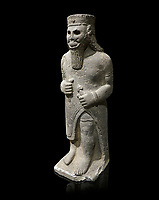 Hittite baslat sculptute of a male, late Hittite Period - 900-700 BC. Adana Archaeology Museum, Turkey. Against a black background