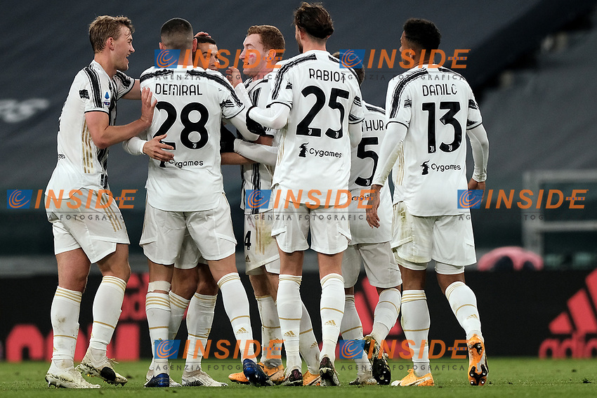 Cristiano Ronaldo of Juventus FC celebrates with team mates after scoring a goal of during the Serie A football match between Juventus FC and Cagliari Calcio at Allianz stadium in Torino (Italy), November21th, 2020. Photo Federico Tardito / Insidefoto