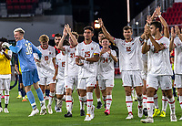 WASHINGTON, DC - SEPTEMBER 6: Maryland players salute the fans after a game between University of Virginia and University of maryland at Audi Field on September 6, 2021 in Washington, DC.