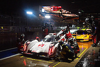Marcel Fassler / Andre Lotterer / Benoit Treluyer of Audi Sport Team Joest (2) LMP1 - H Audi R18 e-tron quattro in the pit road during FIA World Endurance Challenge free practice #2, Thursday, September 18, 2014 in Austin, Tex. (Gary Faulkenberry/TFV Media via AP Images)